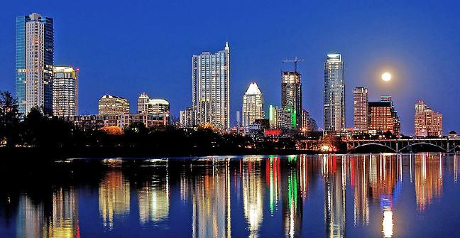 Night view of Austin skyline and Lady Bird Lake as seen from Lou Neff Point. Picture by LoneStarMike 29/03/2010. Licensed under the Creative Commons Attribution 3.0 Unported license.